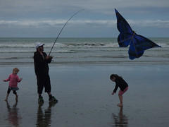 Catching Butterflies (Steve Taylor (Photography)) Tags: fishing rod butterfly trainers cap blue black pink happy fun children girl man newzealand nz southisland canterbury christchurch newbrighton beach ocean pacific sea waves