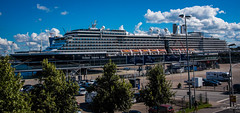 2016 - Baltic Cruise - Kiel Germany - Zuiderdam (Ted's photos - For Me & You) Tags: 2016 balticcruise cropped tedmcgrath tedsphotos vignetting kiel kielgermany ship zuiderdam hal hollandamericaline boat flags streetscene street port kielport vehicles fencing bollards