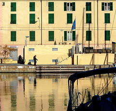 a passeggio nell'oro (fotomie2009) Tags: italy reflection dedication yellow reflections gold riviera italia harbour liguria porto riflessi amicizia riflesso ligure savona ponente rivieradiponente portodisavona ponenteligure