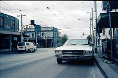 jaws (lonely radio) Tags: film fitzroy australia melbourne rangefinder headlights victoria wires oldcars leicam6 pc3065 auspctagged gertrudest holdenpremier kodakektar100 canon35mmf2ltm