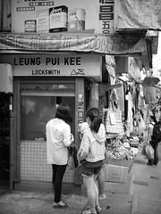 little locksmith (Fion N.) Tags: life city people urban blackandwhite bw hongkong living memories central streetphotography local    locksmith hongkongisland    streetphotographer gf1  hongkonglife     panasoniclumixgf1
