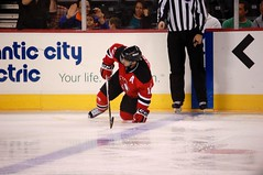 Down But Not Out (Gracers25) Tags: game get ice hockey up hurt team devils injury player again players try phantoms