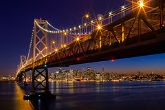 Bridging the Gap [Explored] (boingyman.) Tags: sf sanfrancisco city longexposure bridge night canon landscape island lights cityscape baybridge yerba scape stich buena 35l t2i boingyman