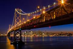 Bridging the Gap (boingyman.) Tags: sf sanfrancisco city longexposure bridge night canon landscape island lights cityscape baybridge yerba scape stich buena 35l t2i boingyman
