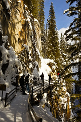 Johnston Canyon, Banff National Park, Alberta, Canada (Warren Justice) Tags: winter vacation snow snowy highcontrast canyon tourists handheld banff gorge rockymountains wintertime vivitar catwalk rockwall snowcovered snowscene winterscape banffnationalpark parkscanada douglasfir wintervacation canadianrockies winterscene mountaintrail canadianwinter johnstoncanyon outdoorrecreation bowvalleyparkway winterhiking hikingtrails travelalberta harshlighting mountainscene mountainscenery snowandice snowladen snowcoveredtree winterphotography snowybranches vivitarseries1 verticalcomposition vacationdestinations winteryscene johnstoncreek canmorealberta canadiannationalparks holidaydestination winterpicture canadianwilderness vivitarlens winterdestination busyscene vivitar28mmf19 canadianparks infullsun intherockies sonynex sonynex3 vivitar28mmf19series1 canadianhikingtrails