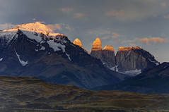 Torres Del Paine, Chile - Sunrise Over Towers of Paine (GlobeTrotter 2000) Tags: chile park travel patagonia mountain lake tourism southamerica argentina landscape lago grey hiking towers visit hike glacier granite andes torresdelpaine horn pillars cuernos paine puertonatales pehoe sarmiento puntaarenas greyglacier nordenskjld towersofpaine