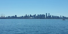City skyline on a summer's day (walneylad) Tags: vancouver britishcolumbia canada downtown city skyline blue water sun bluesky summer august pacificocean sea burrardinlet haze tug tugboat cranes skyscrapers highrise buildings urban landscape scenery view nature