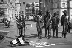 """""""what would they think if I sang out of tune?"""" (shoot what you see) Tags: liverpool thebeatles johnpaulringojohn pierhead artist singer performer cavernclub matthewstreet street candid mono 2016 diabetes eightdaysaweek statue leica 50mm summilux m246 monochrom pauljones xfactor lipa thecavernclubbeatles"""