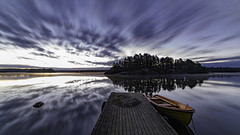 Sunday morning (wider) (jarnasen) Tags: nikon d810 samyang14mmf28 wideangle angle tripod longexposure le nature version alt nordiclandscape scandinavia sverige sweden water sky himmel clouds movingclouds jetty boats sunrise dawn sunlight early morning autumn copyright jrnsen jarnasen comparison colour color outdoor stergtland storarngen vrdns lake lakescape landscape explore explored mist clear blue red orange reed island weather naturfoto gallery perspective pov superwide