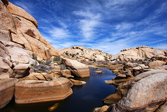 Joshua Tree's Barker Dam (Dave Toussaint (www.photographersnature.com)) Tags: oasis joshuatreenationalpark barkerdam mojavedesert rock geology desert america southwest water clouds joshuatree socal southern california ca usa exploring travel nature landscape topazlabs denoise infocus adjust simplify adobe cs2 photoshop canon 40d photographersnaturecom photo 2009 march davetoussaint worldwidelandscapes panoramafotogrfico topshots theoriginalgoldseal magicmomentsinyourlifelevel1 blinkagain flickrstruereflection3