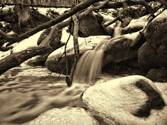 Swan Song of the Falls~ sepia (Mulewings~) Tags: kitlens timedexposure rawformat waterrunoff creekbottom creekhike creekadventure olycamera topazediting afteraflashflood wateroverboulders wateroverice