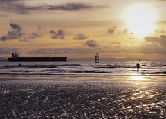 Glorious light (Bev Goodwin) Tags: light sunset england beach clouds liverpool ironman tanker crosby antonygormley merseyside anotherplace ironmen crosbybeach
