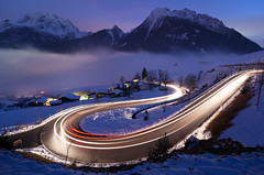 Let there be Light!! (daitoZen) Tags: road longexposure winter light mountain snow car night turn germany landscape bavaria evening berchtesgaden scenery stream europe glow traffic bend dusk trails bluehour curve sweep hairpin steinberg lighttrail blaue ramsau bgl blauestunde watzmann stunde hochkalter imgp7523