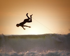 Hangin Around (McSnowHammer) Tags: ocean sunset france beach silhouette surfer air wave hossegor surfing