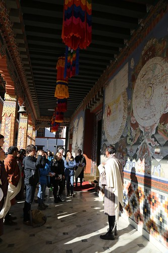Tour guide Hishey Tshering lectures students on Bhutanese culture (Thimphu, Bhutan)