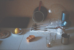 Toasts (Andrey Timofeev) Tags: light film home kitchen glass 35mm reflections notebook table mugs lemon twilight shadows room knife plate fork shades pot dishes tones canonae1program toasts spoons           35     ferraniasolaris400  facetedglass       february2013 canonlensfd50mm14