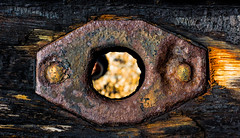 Fire in the hole! (Charlie Locke) Tags: wood orange black metal contrast rust hole bright decay vibrant dirt burn burnt colourful corrosion corrode charcole