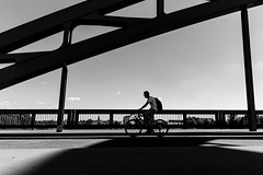 Cycling on the Bridge (Jan Jespersen) Tags: 28mm canon magdeburg bridge city citylife street streetphoto streetphotography urban urbanlife urbanscene urbanscenes