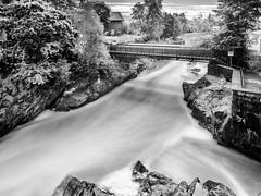 Vanhankaupunginkoski (tkaiponen) Tags: bridge trees blackandwhite monochrome finland helsinki rocks long exposure outdoor rapids nd vanhakaupunki koski vanhankaupungin nd1000