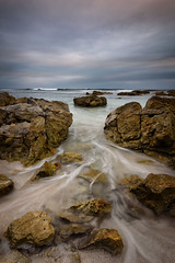 Shattered Dreams (Rodney Campbell) Tags: mollymook sunrise water sky gnd06 cpl ocean clouds rocks newsouthwales australia au