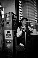 I've Had a Happy Life (stimpsonjake) Tags: nikoncoolpixa 185mm streetphotography bucharest romania city candid blackandwhite bw monochrome oldman cane happy hat