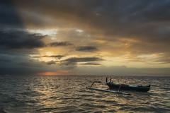 La barque (Pillg) Tags: sunrise sanur boat barque bateau light lumire clouds nuages ocean bali sea mer landscape paysage water