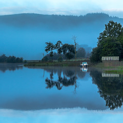 Blues (rgcxyz35) Tags: lochard trossachs nationalpark reflections kinlochard boats boathouse lochs scotland clouds