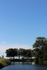 Waterline (Epochend) Tags: sweden landskrona trees water horizon