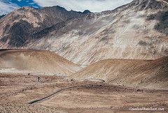 Mountain road in Nubra Valley, North India (CreativePhotoTeam.com) Tags: valley sky hill ams beauty ladakh highway pakistan asia clouds summer peak travel nature altitude road indian hairpinturn outdoor scene view adventure journey aerial tourism pass mountain india leh jammu range kashmir beautiful trekking glacier landscape trafic tibet tibetan hairpin himalayan afganistan hiking mountaineering himalaya panorama nepal jammuandkashmir scenery snow