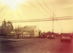 (Photosintheattic (Devy)) Tags: buildings trucks dusk vehicles trees lines powerlines photoeffects effects signs vintage mood