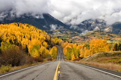 San Juan Mountains Colorado (Bryan the Roving Vagabond) Tags: telluride colorado fall foliage autumn co usa roadway highway color leaves clouds yellow gold road outdoor landscape explore san juan mountains trees tree lines infinity curve 145 state nikon d610 depth