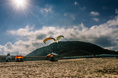 starburst..! (photomaster.shifu) Tags: adventure outings paragliding photographer photography d300 kitlens starbursts sunrays sun sky sea mountain jump group blueskies 18140 taiwan taipei wanli specialshots specialmoments flying flyinghigh wind clouds ocean