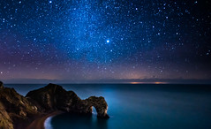 Milky Way Above Durdle Door (DorsetScouser) Tags: sea holiday tourism beach portland stars landscape star coast seaside landmark coastal astrophotography dorset orion destination astronomy jupiter weymouth astrology constellation stargazing milkyway durdledoor dorsetcoast southdorset