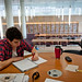 A students takes advantage of the many independent study areas inside of the Hunt Library.