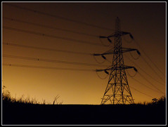 Pylon Glow (Jon 89) Tags: uk nightphotography light england sky plants black tower english field grass lines silhouette yellow electric skyline night danger rural dark walking landscape photography gold lights golden evening countryside town photo spring big high track glow village power view britain near path walk live united country hill great may kingdom scene farmland structure line pylon company trail wires gb electricity letchworth fields after british tall agriculture outline footpath hertfordshire willian towering 2012 supply publicfootpath herts braycottages