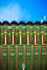 Standing Tall (ohad*) Tags: camera blue color building green yellow canon lens place objects palace korea seoul southkorea ohad changdeokgung changdeokgungpalace 50d ohadonline jongnogu canon50d canonef24105mmf4 ohadbenyoseph ohadme ohadby