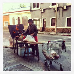 Sidewalk asado. (gak) Tags: valencia square uruguay meat grill sidewalk squareformat montevideo asado aguada iphone iphoneography instagram instagramapp uploaded:by=instagram foursquare:venue=51019b5ae4b077344917d045