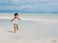 Sun, sea and sand (ubo_pakes) Tags: boy sky cloud sun white playing beach wet water clouds boat kid sand nikon asia surf waves child play small philippines joy young wave running run bohol visayas banka panglao d60 ubo pakes mygearandme mygearandmepremium