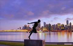 Watching Over The City (Clayton Perry Photoworks) Tags: statue skyline night vancouver reflections lights stanleypark canadaplace hdr coalharbour harryjerome