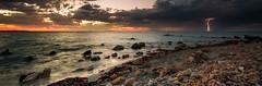 Sunset lightning (Slow Roaming) Tags: ocean sunset storm colour rocks indianocean lightning woodmanpoint
