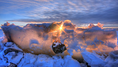 Sunset Hot Spot (Adam's Attempt (at a good photo)) Tags: blue sunset sky sun white snow cold reflection ice yellow rock clouds reflections utah nikon cloudy bluesky sunburst hdr utahlake utahcounty d90 americanfork photomatix iceformations cs5 lr4 americanforkut utahlakesunset americanforkboatharbor sunsethotspot