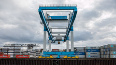 crane & containers (eddy.kamalsky) Tags: crane harbour container shipping industry outdoor maersk symmetry leading lines urbex rails huge international heavy transport blue red tracks