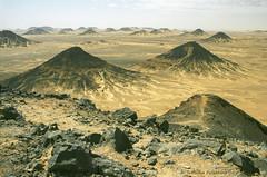 Black Desert, Egypt (Svetlana Polukhina) Tags: yellow      egypt sahara desert sand film 35mm analog black stone africa   libiandesert  fuji reala