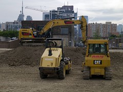 Excavator Envy (geowelch) Tags: downtown toronto urbanfragments urbanlandscape constructionsite panasoniclumixgx1 panasoniclumixgvario1232mm3556