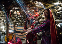 Wakhi nomad women making butter in the pamir mountains, Big pamir, Wakhan, Afghanistan (Eric Lafforgue) Tags: 3034years adultsonly afghan169 afghanistan anthropolgy badakhshan bigpamir butter centralasia colourimage community cultures headscarf horizontal indigenousculture indoors ismaili lifestyles light lookingatcamera maidenvillage milk nomad nomadicpeople people photography ray rayoflight sunbeam sunlight traditionalclothing twopeople veil wakhancorridor wakhi women womenonly working wakhan pamir afeganisto