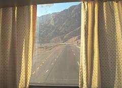 Farewell Aqaba (Yazan_) Tags: aqaba middleeast desert wadirum wadi rum mountains sunset road track path trail window bus car leaving bye bi farewell