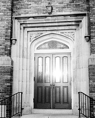 Doorway to Redemption (Dalliance with Light) Tags: milltown building monochrome church scans reflection doorwaytoredemption ilfordhp5 olympus35sp bw door film light newjersey unitedstates us