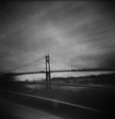 Using a Trimet bus as a photo accessory (Zeb Andrews) Tags: holga stjohnsbridge longexposure kodaktrix blackwhite portland 6x6 mediumformat blur bridge urban cityscape