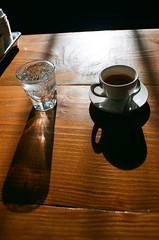 Espresso (Chayne Sturgeon) Tags: coffee coffeeshop ict wichita espresso cafe mineral water morning light shadow film 35mm ektar kodak 100 reverie roasters