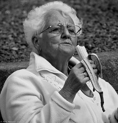 Britains love affair with the Banana. (Neil. Moralee) Tags: dunsterneilmoralee neilmoralee woman mature old eating banana white hair glasses face portrait close uk dunster castle candid black bw mono monochrome neil moralee nikon d7100 fruit eat granny grandmother mother peel wrinkle outdoor fresh stare humour funny health healthy sleep